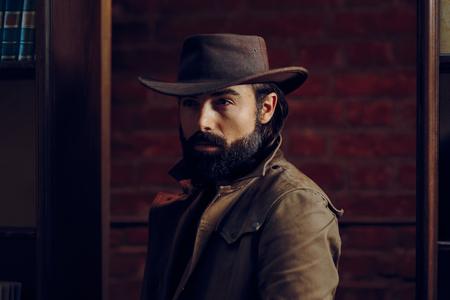 Handsome Man Wearing Cowboy hat in western style portrait