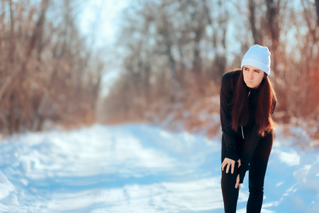 Woman Suffering Running Injury Leg Accident in Winter Training Session