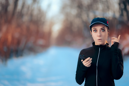 Funny Fitness Woman Listening to Music on Her Smartphone Stock Photo