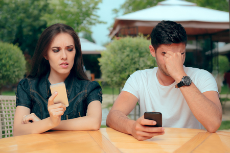 Curious Girlfriend Checking Boyfriend Phone Receiving Texts Messages
