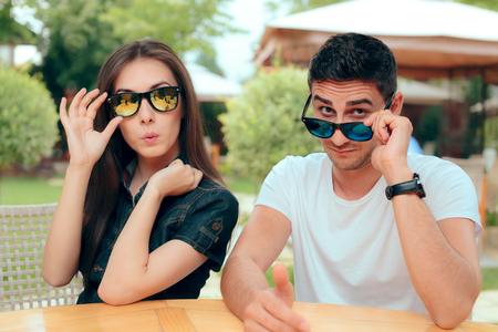 Surprised Couple Wearing Matching Trendy Fashion Sunglasses