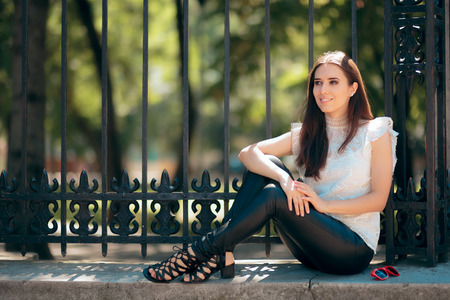 Beautiful Woman Wearing Leather pants Relaxing Outdoors Stock Photo