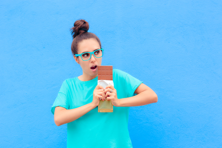 Funny Woman on Diet Craving Big Dessert Chocolate Bar Stock Photo