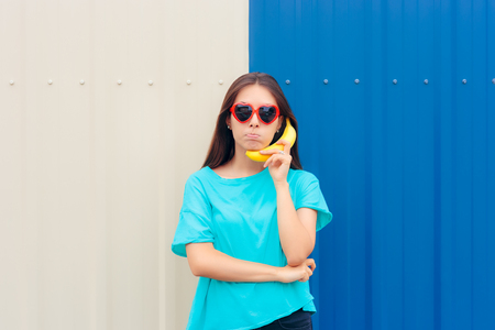 Heart Shape Sunglasses Woman with Funny Banana Phone Stock Photo