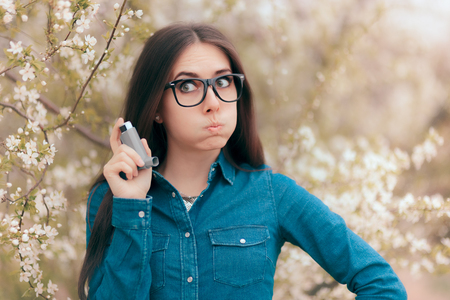 Allergic Woman with Asthmatic Symptoms Holding Asthma Inhaler Spray Stock Photo