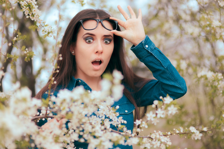 Funny Girl Surrounded by Blossoming Trees Afraid of Allergies
