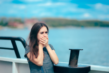 Sea sick woman suffering motion sickness while on boat 스톡 콘텐츠
