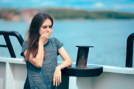 Sea sick woman suffering motion sickness while on boat Stock Photo