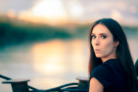 Surprised Funny Girl By the See at Sunset Stock Photo