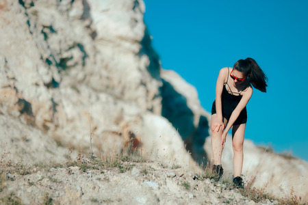 Female Jogger Feeling Leg Pain After Running Accidental Injury Foto de archivo
