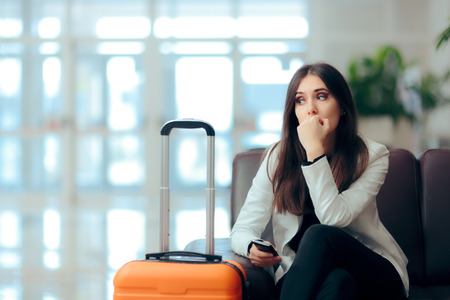 Sad Melancholic Woman with Suitcase in Airport Waiting Room