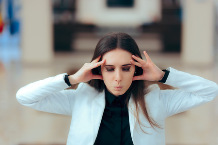 Stressed Business Woman in Pain Having Serious Headache Stock Photo