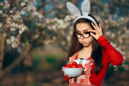 Funny Tired Housewife with Bunny Ears, Apron and Easter Eggs