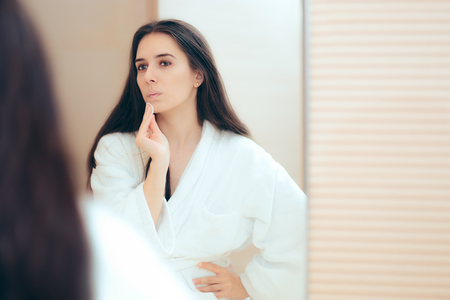 Woman in Bathrobe Cleaning Her Face with Make-up Remover