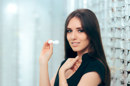 Happy Woman Holding Contact Lenses Case in Optician Store