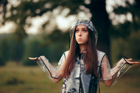 Surprised Woman in Clear Transparent Raincoat in Summer Rain