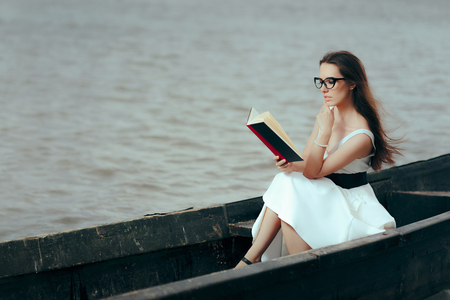 Retro Woman Reading a Book in a Vintage Boat