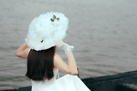 Woman With Bridal White Hat and Gloves Admiring the Sea