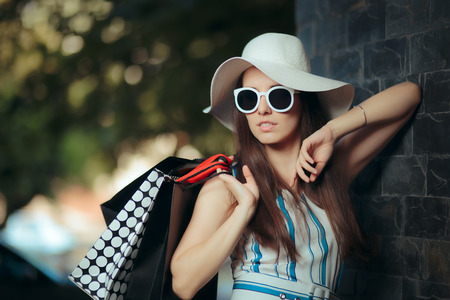 Summer Girl with Hat and Sunglasses and Shopping Bags