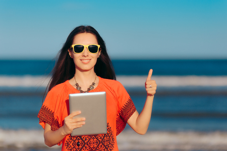 Happy Girl With PC Tablet on The Beach Stock Photo
