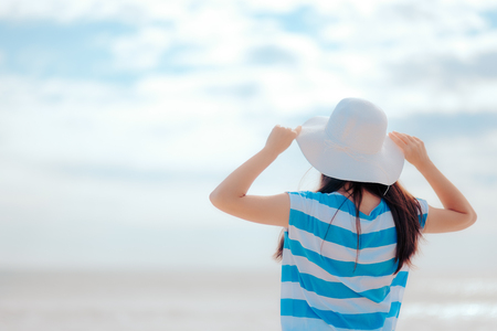 Summer Woman with White Straw Sun Hat at the Beach