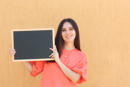 Cheerful Woman Holding Blackboard Advertising Sign