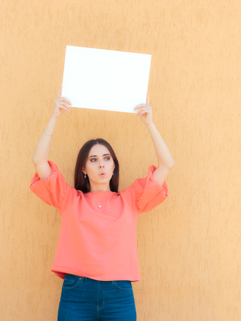 Cheerful Woman Holding White Blank Advertising Sign