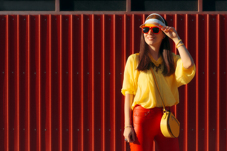 Cool Urban Summer Fashion Woman with Sunglasses and Clear Visor Stock Photo