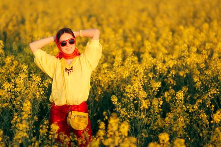Retro Fashion Woman Wearing Headscarf in Rapeseed Flower Field