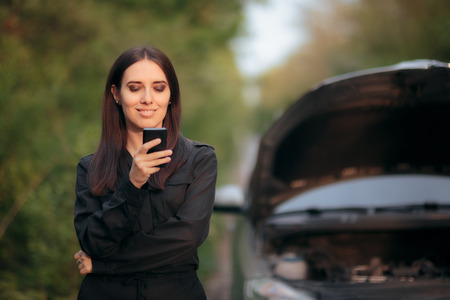 Driver Calling Insurance Company after Car Breakdown on the Road Stock Photo