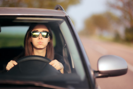 Stressed female driver on a summer vacation road trip