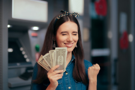 Excited Woman Receiving Salary at ATM Teller Machine