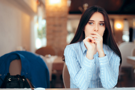 Sad Woman Removing Wedding Ring Thinking about Divorce