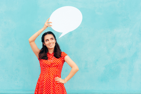 A retro girl with speech bubble making an announcement Stock Photo