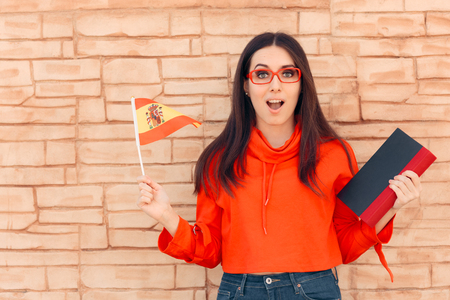 Student Holding Flag and Book Learning Foreign Language Archivio Fotografico