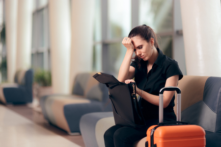 Forgetful Girl Checking her Bag in an Airport Stockfoto