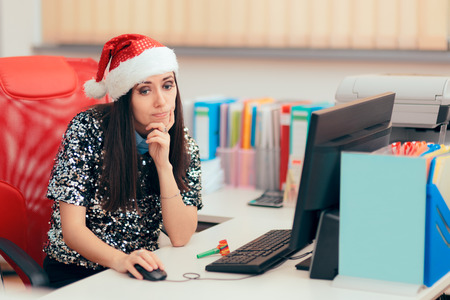 Sad Woman Spending Christmas Holiday at the Office 写真素材 - 110775928