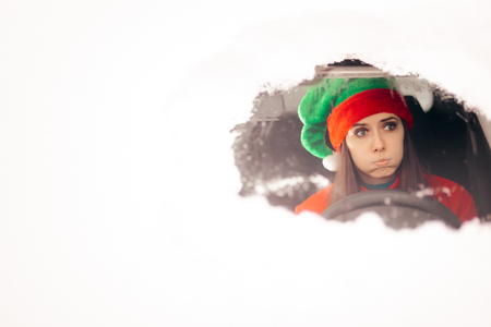 Funny Christmas Girl Driving Through the Snow on Bad Weather Stok Fotoğraf