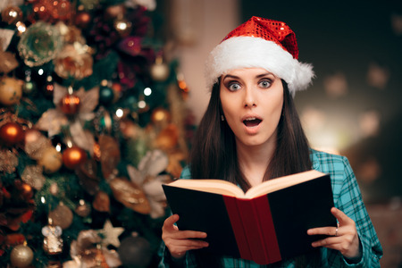 Girl Wearing Santa Hat Reading Story Tale Book