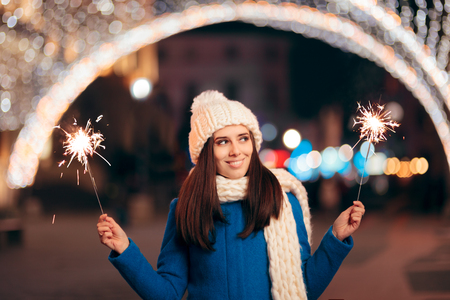 Cheerful Girl with Fireworks Outdoors Celebrating Winter Holidays
