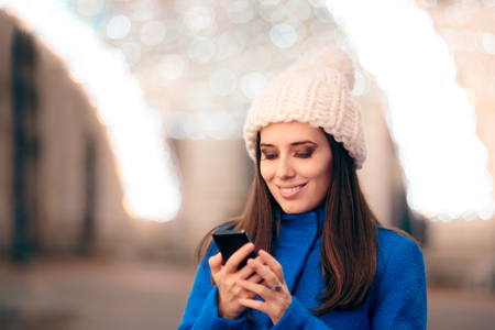Happy Girl Reading Holiday Greetings Text Messages