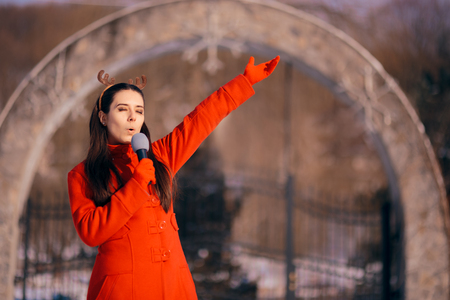 Christmas Girl Singing Carols Outdoors in Wintertime