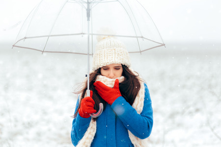 Winter Woman Fighting The Wind Holding Umbrella Stock Photo