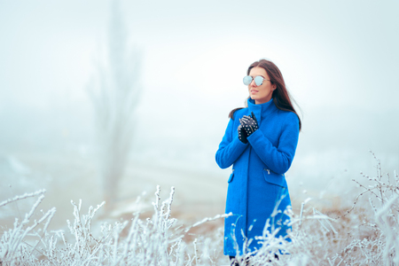 Fashion Winter Woman with Mirror Sunglasses and Blue Coat