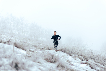 Female Jogger Running Outdoors in Winter Cold Stock fotó