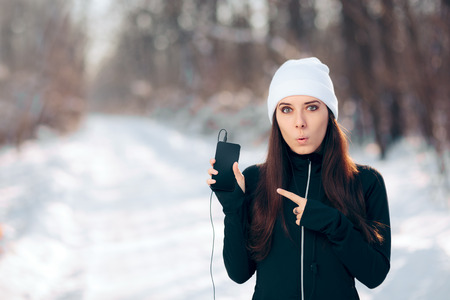 Winter Smartphone Girl Listening to Music Radio Using Earphones Фото со стока