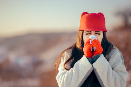 Sick Woman with Tissue Having a Bad Case of Flu