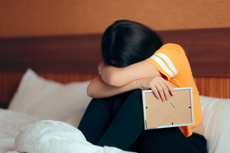 Sad Depressed Girl Crying After Break-up Holding Framed Picture