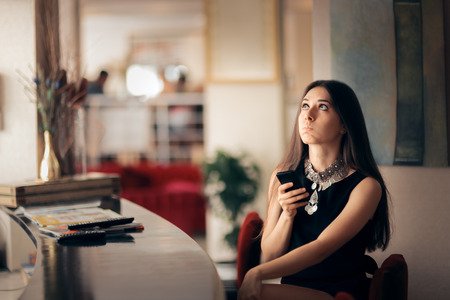 Funny Bored Woman Holding Smartphone Waiting for her Date
