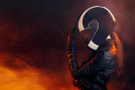 Biker Woman with Helmet and Leather Outfit Portrait Фото со стока - 114142872